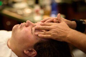 V's patron getting a facial massage