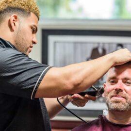 V's Arcadia Phoenix Interior barber giving a beard trim