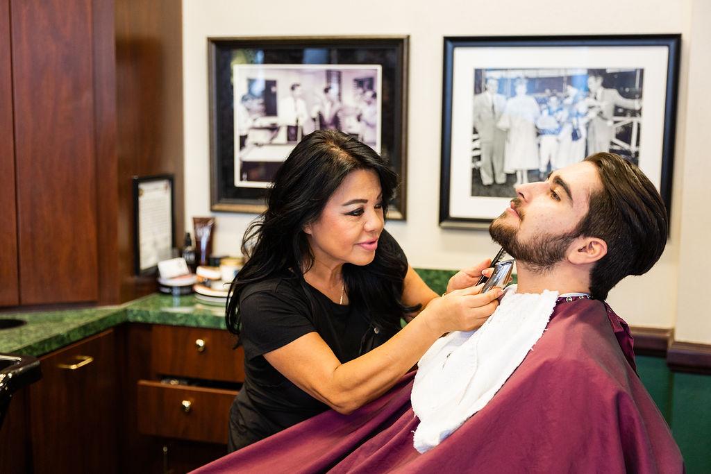 barber cuts beard